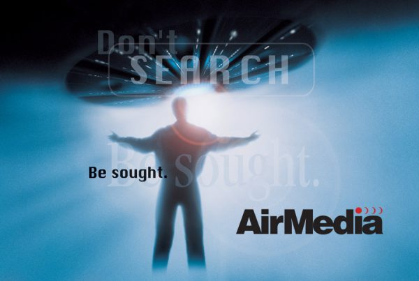 AirMedia brand magazine advertisement showing ufo in distance with brilliant white light and man with outstretched arms waiting to be taken. Text overlay says
