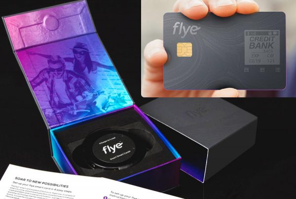 packaging design of Flye smart credit card packaging. rigid box packaging with open lid and colorful blend of blue, purple and magenta colored lifestyle photo. Outer packaging design is a gray two toned linear wind image. Smart card is designed the same way with hand holding it to show its features.