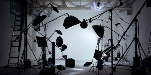 Product photography studio with lighting equipment around the table
