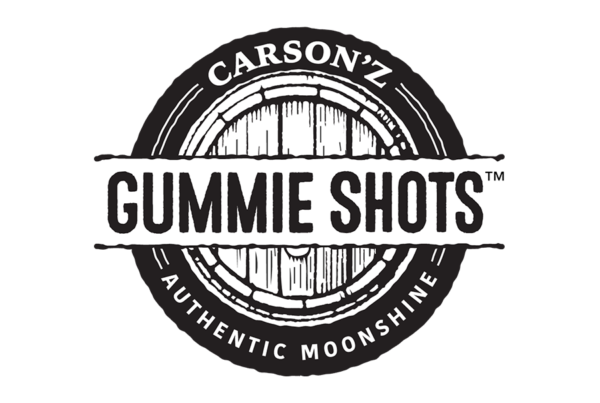 Gummie Shots word set straight on top of old weathered oak barrel end behind it. Carson'z Authentic Moonshine Shots runs around it in a circle