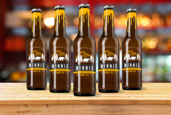Winnie the Brew Honey Ale Label Design Bottles Sitting on a Bar Table