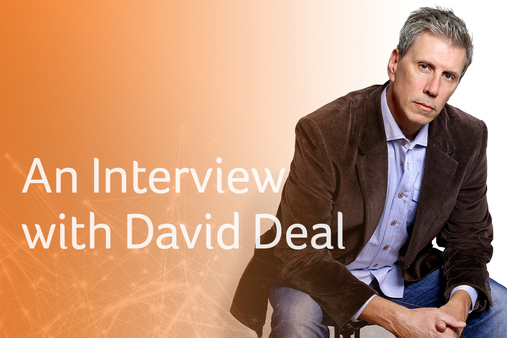 an interview with David Deal, sitting looking intently at camera