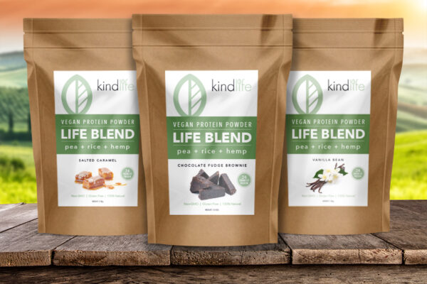 3 package design bags of kind life protein powder sitting on a table top